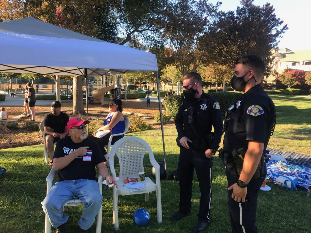 San Jose Police officers talking with a resident at National Night Out